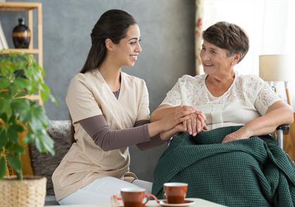 nurse comforting elderly patient in home health care Gracia Hospice